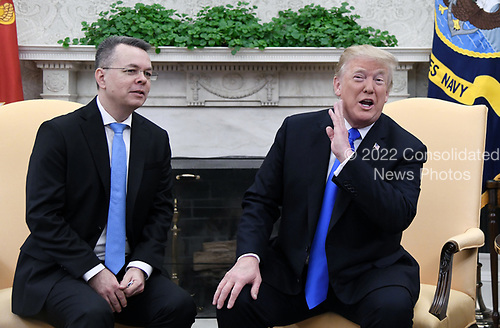 U.S. President Donald Trump meets with Pastor Andrew Brunson in the Oval Office of the White House on October 13, 2018 in Washington, DC. Pastor Andrew Brunson arrived back in the U.S. on Saturday after being held in Turkey for two years on terrorism charges. Photo by Olivier Douliery/ Abaca Press<br /> Credit: Olivier Douliery / Pool via CNP