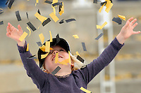One of winner Matt Kenseth's daughters plays with the confetti in Victory Lane.