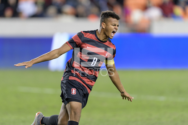 Houston, TX -  Friday, December 9, 2016: Brian Nana-Sinkam (8) of the Stanford Cardinal celebrates after making a goal during the overtime shootout against the North Carolina Tar Heels at the  NCAA Men's Soccer Semifinals at BBVA Compass Stadium.
