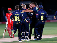 Adam Milne is mobbed after bowling Arron Lilley during the T20 Quarter-Final game between Kent Spitfires and Lancashire Lightning at the St Lawrence ground, Canterbury, on Aug 23, 2018.