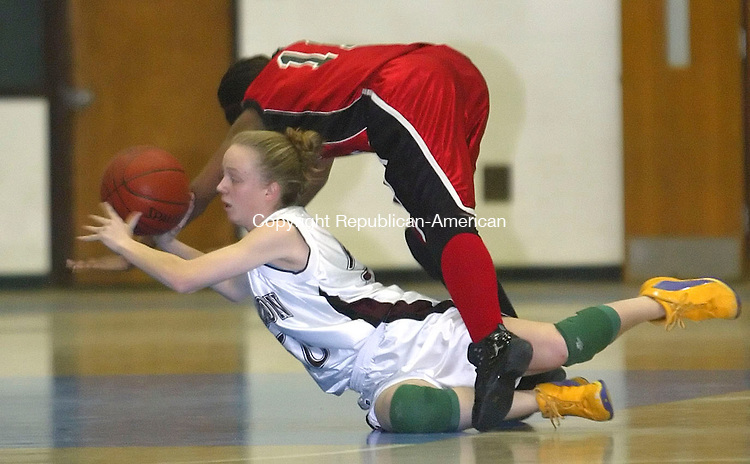 GLASTONBURY, CT, 03/06/07- 030607BZ13- Torrington's Michelle Royals (50) and Manchester's  Shaina Barr (11) dive for the loose ball during the Class LL semifinals at Glastonbury High School Tuesday. <br /> Jamison C. Bazinet Republican-American