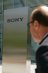 A man walks past a Sony signboard on display outside company's headquarters on May 23, 2017, Tokyo, Japan. Kazuo Hirai, President and Chief Executive Officer of Sony Corp. announced Sony's midterm financial targets for the current fiscal year ending March 31, 2018. (Photo by Rodrigo Reyes Marin/AFLO)
