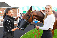Stable staff tend to Pempie in the Winners enclosure after winning The Graham Fitch Birthday Celebration Classified Stakes during Evening Racing at Salisbury Racecourse on 25th May 2019