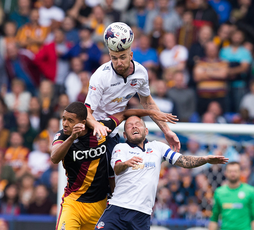 Bolton Wanderers' Mark Beevers rises above Jay Spearing and Bradford City's Timothee Dieng<br /> <br /> Photographer James Williamson/CameraSport<br /> <br /> The EFL Sky Bet League One - Saturday 24th September 2016 - Bolton Wanderers v Bradford City - Macron Stadium - Bolton<br /> <br /> World Copyright &copy; 2016 CameraSport. All rights reserved. 43 Linden Ave. Countesthorpe. Leicester. England. LE8 5PG - Tel: +44 (0) 116 277 4147 - admin@camerasport.com - www.camerasport.com