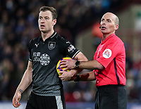 Burnley's Ashley Barnes loses the ball to referee Mike Dean<br /> <br /> Photographer Andrew Kearns/CameraSport<br /> <br /> The Premier League - Huddersfield Town v Burnley - Wednesday 2nd January 2019 - John Smith's Stadium - Huddersfield<br /> <br /> World Copyright © 2019 CameraSport. All rights reserved. 43 Linden Ave. Countesthorpe. Leicester. England. LE8 5PG - Tel: +44 (0) 116 277 4147 - admin@camerasport.com - www.camerasport.com