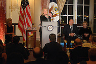 October 27, 2011  (Washington, DC)  Secretary of State Hillary Rodham Clinton speaks at the 50th Anniversary Celebration of the Diplomatic Rooms at the State Department in Washington.  On stage (L-R) Andrea Mitchell, NBC Chief Foreign Affairs Correspondent; Former Secretary of State Colin Powell;  Former Secretary of State  Madeleine K. Albright (Photo by Don Baxter/Media Images International)