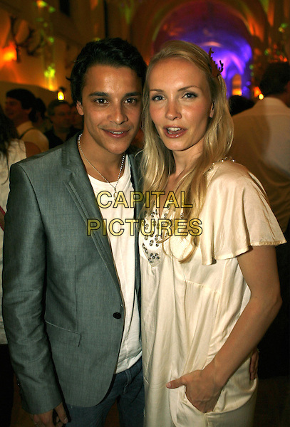 KOSTJA ULLMANN & JANINE REINHARDT.Shocking Shorts Award 2009, Filmfest Munich, Germany..June 30th, 2009.half length grey gray suit jacket white dress .CAP/PPG/TF.©T. Furthmayr/People Picture/Capital Pictures