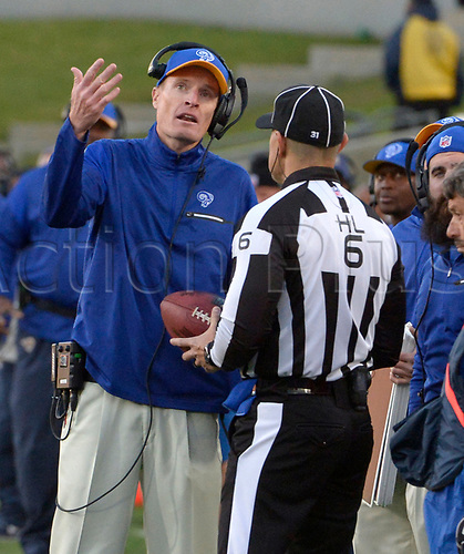 December 24th 2016, Los Angeles, California, USA; Los Angeles Rams interim head coach John Fassel talks with a official in the second half of a NFL football game at the Los Angeles Memorial Coliseum