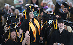 Graduates wave to their friends and family during the 45th annual Western Nevada College Commencement ceremony in Carson City, Nev., on Monday, May 23, 2016. A record 556 graduates received 598 degrees.<br />