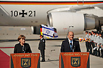 German Chancellor Angela Merkel with Israeli Prime Minister Ehud Olmert, during a welcoming ceremony at Ben Gurion airport in Israel, Sunday, March 16, 2008.<br /> <br /> (Photo by Ahikam Seri).