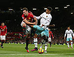 Phil Jones of Manchester United gets in the middle of an attack with Pedro Mba Obiang of West Ham United during the Premier League match at the Old Trafford Stadium, Manchester. Picture date: November 27th, 2016. Pic Simon Bellis/Sportimage