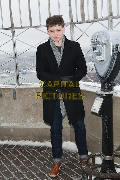 NEW YORK, NY - FEBRUARY 9: Taron Egerton promotes 'Kingsman: The Secret Service' at The Empire State Building on February 9, 2015 in New York City. <br /> CAP/MPI/DIE<br /> &copy;DIE/MPI/Capital Pictures