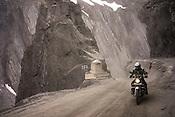 A motorcyclist rides on the Leh-Srinagar highway in Ladakh region of Kashmir, India.