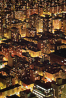 THIS PHOTO IS AVAILABLE EXCLUSIVELY FROM GETTY IMAGES.  ....Please search for image # 487987 on www.gettyimages.com....Aerial View of Buildings in Midtown Manhattan at Night, New York City, New York State, USA