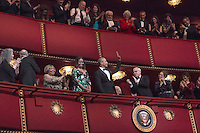 United States President Barack Obama and First Lady Michelle Obama wave at the beginning of a show for the Kennedy Center Honorees at the Kennedy Center, December 4, 2016, Washington, DC. The 2016 honorees are: Argentine pianist Martha Argerich; rock band the Eagles; screen and stage actor Al Pacino; gospel and blues singer Mavis Staples; and musician James Taylor. Photo Credit: Aude Guerrucci/CNP/AdMedia