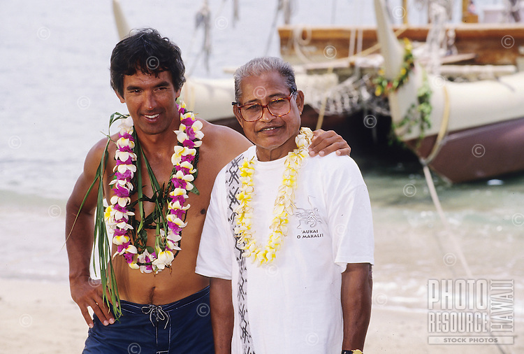 Master navigator Nainoa Thompson (left) and his teacher, master navigator Mau Piailug (right), with Polynesian voyaging canoe Hokule'a in the background, Kahului, Maui, circa 1998.