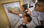 Boys find their place on the map at Zakiah's pride campaign visit with school kids in Lok Nga village.