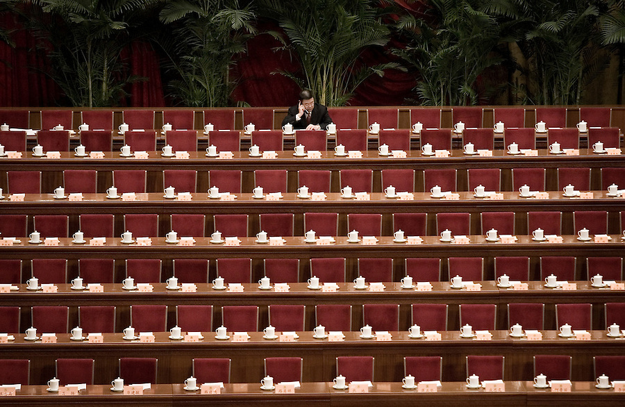 A delegate make a call on a mobile phone in the Great Hall of the People before a session of the National People's Congress, China's Parliament.