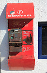 Old disused broken Comytel public telephone booth phone, Almeria, Spain