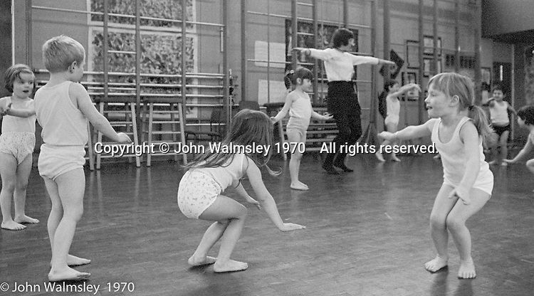 Music and movement, exercises in the gym, Vittoria Primary School, Islington, London.  1970.