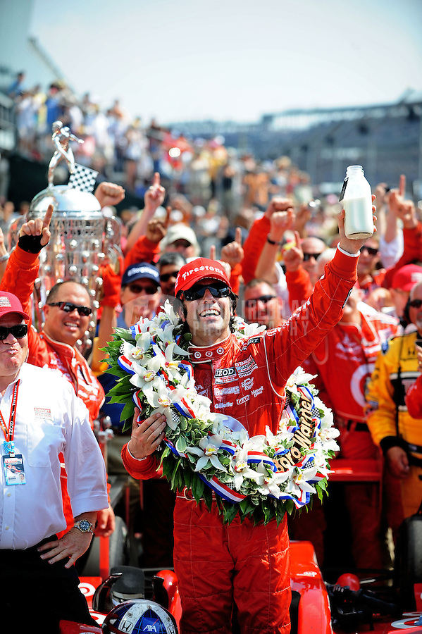May 30, 2010; Indianapolis, IN, USA; IndyCar Series driver Dario Franchitti celebrates after winning the Indianapolis 500 at the Indianapolis Motor Speedway. Mandatory Credit: Mark J. Rebilas-