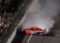 Jul. 5, 2008; Daytona Beach, FL, USA; NASCAR Sprint Cup Series driver Jeff Burton (31) and Casey Mears (5) crash during the Coke Zero 400 at Daytona International Speedway. Mandatory Credit: Mark J. Rebilas-