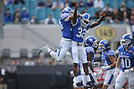 Linebacker Jordan Jones #34 of the Kentucky Wildcats celebrates with linebacker Eli Brown #32 after a tackle during the first half of the TaxSlayer Bowl against the Georgia Tech Yellow Jackets at EverBank Field on Saturday, December 31, 2016 in Jacksonville, Florida. Photo by Michael Reaves | Staff.