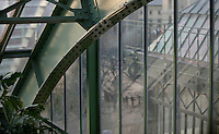 Tropical Rainforest Glasshouse (formerly Le Jardin d'Hiver or Winter Gardens), 1936, René Berger, Jardin des Plantes, Museum National d'Histoire Naturelle, Paris, France. Detail of the glass and metal roof structure, seen from the roof of the cave, with the New Caledonia Glasshouse (formerly The Mexican Hothouse) on the right, 1834, Charles Rohault de Fleury, in the background.
