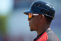 Hickory Crawdads infield coach Joshua Johnson (1) coaches first base during the game against the Charleston RiverDogs at L.P. Frans Stadium on May 13, 2019 in Hickory, North Carolina. The Crawdads defeated the RiverDogs 7-5. (Brian Westerholt/Four Seam Images)