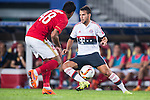 (R) Juan Bernat of Bayern Munich being followed by (L) Paulinho of Guangzhou Evergrande during the Bayern Munich vs Guangzhou Evergrande as part of the Bayern Munich Asian Tour 2015  at the Tianhe Sport Centre on 23 July 2015 in Guangzhou, China. Photo by Aitor Alcalde / Power Sport Images