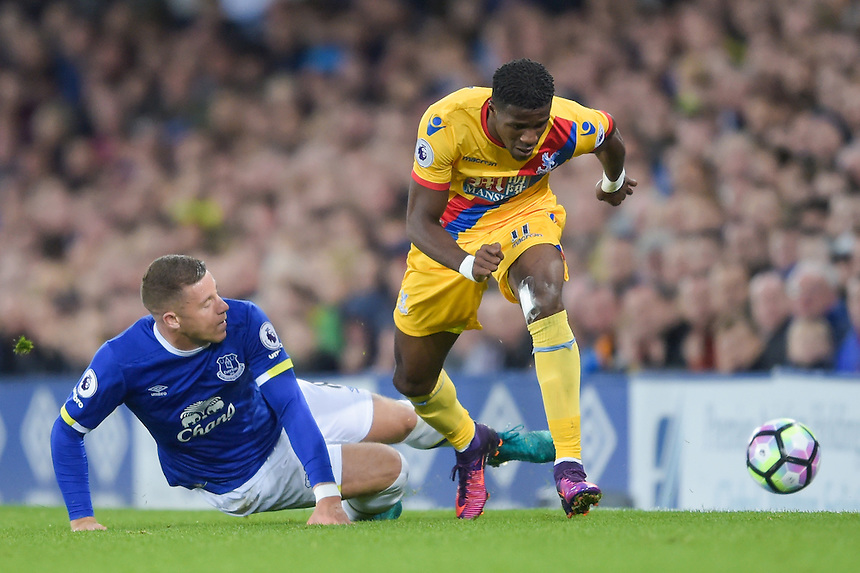 Crystal Palace's Wilfried Zaha is tackled by Everton's Ross Barkley<br /> <br /> Photographer Terry Donnelly/CameraSport<br /> <br /> The Premier League - Everton v Crystal Palace - Friday 30th September 2016 - Goodison Park - Liverpool<br /> <br /> World Copyright &copy; 2016 CameraSport. All rights reserved. 43 Linden Ave. Countesthorpe. Leicester. England. LE8 5PG - Tel: +44 (0) 116 277 4147 - admin@camerasport.com - www.camerasport.com