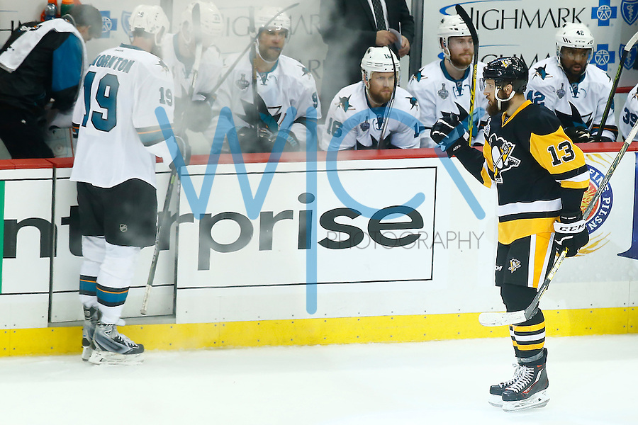 Nick Bonino #13 of the Pittsburgh Penguins reacts following his game-winning goal in the third period past against the San Jose Sharks during game one of the Stanley Cup Final at Consol Energy Center in Pittsburgh, Pennslyvania on May 30, 2016. (Photo by Jared Wickerham / DKPS)