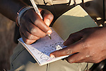 Save the Rhino Trust tracker recording black rhino sighting, Palmwag concession, Kunene region, Namibia