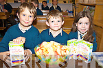 TUCKING IN: Michael O'Sullivan, Jack Griffin and Amanda Flynn tucking in at the Childline breakfast morning at the Nagle-Rice national school in Milltown on Friday morning.