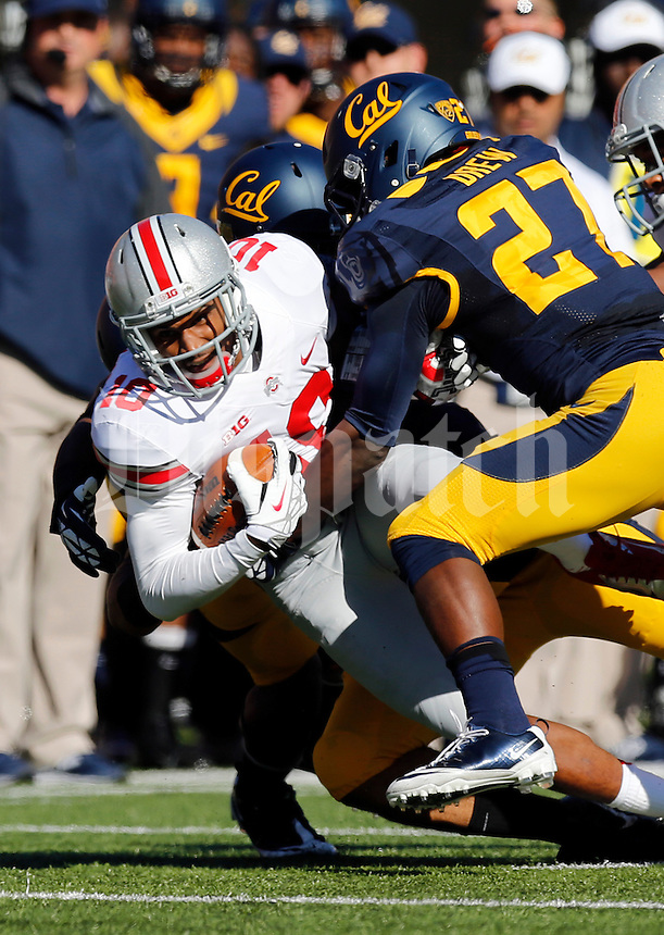 Ohio State Buckeyes wide receiver Philly Brown (10) lunges for extra yardage past California Golden Bears defensive back Damariay Drew (27) during the first quarter of the NCAA football game at Memorial Stadium in Berkeley, California on Sept. 14, 2013. (Adam Cairns / The Columbus Dispatch)