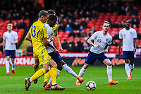 Fulham's midfielder Ryan Sessegnon (11) for England U21's  under pressure from ?Valencia CF Mestalla's defender Ivan Zotko (13) for Ukraine U21's during the International Euro U21 Qualification match between England U21 and Ukraine U21 at Bramall Lane, Sheffield, England on 27 March 2018. Photo by Stephen Buckley / PRiME Media Images.