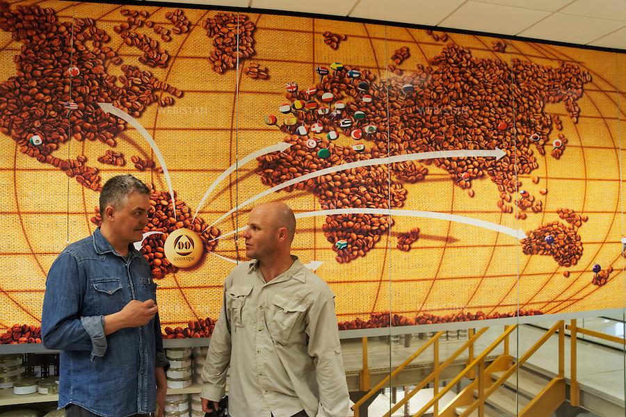 Bresil, etat Minas Gerais, Guaxupe, Cooxupe, 31 octobre 2012.<br /> <br /> Cooxupe est l&rsquo;une des plus grosses cooperatives bresiliennes de cafe. Elle a signe un partenariat avec Nespresso dans le cadre du Programme AAA. Elle dispose de plusieurs sites dont celui de Guaxupe qui s'est dote, en 2008, d'un laboratoire ultra-moderne d'analyse du cafe. <br /> Dans la salle de tracking, a gauche, l'assistant photographe Flavio, et Guilherme Malpighi Amado, representant de Nespresso Bresil, a droite.<br /> Reportage les Chants de cafe_soul of coffee, realise sur les acteurs terrain du programme de developpement durable Triple AAA de Nespresso.<br /> <br /> Brazil, Minas Gerais, Guaxupe, Cooxupe, October 31, 2012 <br /> <br /> Cooxupe, one of the largest coffee cooperatives in Brazil, signed a partnership with Nespresso AAA Program. Cooxupe has several sites, including one in Guaxupe, which in 2008 acquired a state-of-the-art laboratory to analyze coffee. <br /> In the tracking room: left is Flavio, the assistant photographer, and right, is Guilherme Malpighi Amado, a representative of Nespresso Brazil. <br /> Assignment: les Chants de cafe_ Soul of Coffee, implemented on the fields of Nespresso&rsquo;s AAA Sustainable Quality Program.
