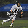 John Arcidiacono #29 of Adelphi University carries downfield during a rain-filled first round game against Pace in the NCAA Division II Tournament at Motamed Field in Garden City, NY on Saturday, May 13, 2017.
