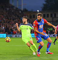 Adam Lallana wins the ball from Joe Ledley during the EPL - Premier League match between Crystal Palace and Liverpool at Selhurst Park, London, England on 29 October 2016. Photo by Steve McCarthy.