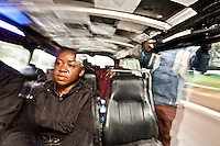 """Catherine, a 32-year- old civil servant rides  the route 46 matatu to work in Nairobi. Solomon Waithaka, the """"conductor"""" leans out the open door to coax more passengers."""