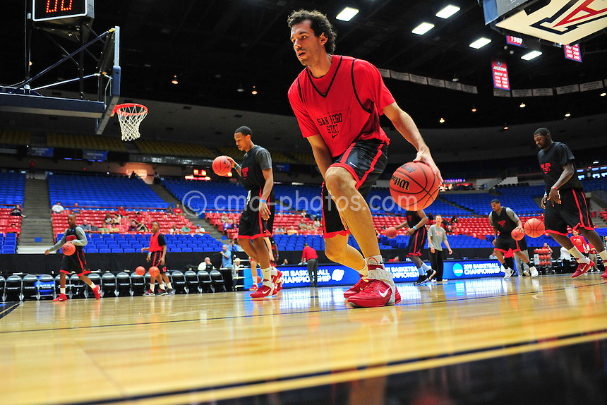 Mar 16, 2011; Tucson, AZ, USA; San Diego State Aztecs forward Mehdi Cheriet (42) dribbles the ball during practice the day before the second round of the 2011 NCAA men's basketball tournament at the McKale Center.