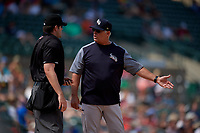 Scranton/Wilkes-Barre RailRiders manager Jay Bell (22) argues a call with umpire John Bacon during an International League game against the Rochester Red Wings on June 25, 2019 at Frontier Field in Rochester, New York.  Rochester defeated Scranton 10-9.  (Mike Janes/Four Seam Images)