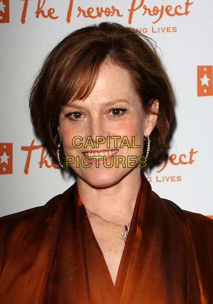 """SIGOURNEY WEAVER.11th Annual Trevor Project's """"Cracked XMas"""" Benefit at the Wiltern Theatre, Los Angeles, California, USA..December 7th, 2008.headshot portrait orange top brown .CAP/ADM/KB.©Kevan Brooks/AdMedia/Capital Pictures."""
