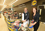 Pictured at the Lidl Christmas Trolley Dash for Barretstown in the Lidl Store at Caherweesheen, Tralee on Saturday is Sandra Leahy from Tralee who managed to grab €249.50 worth of goodies dashing around the store in just 2 minutes. Sandra donated her goodie collection to the Tralee Soup Kitchen and Tralee Animal Shelter. Also in photo is Lidl Store Manager Dorota Hennig and Sales Assistant Shane Manning.<br /> Photo: Don MacMonaqgle<br /> <br /> Repro free photo from LIDL<br /> <br /> Further info: Claire.Moran@lidl.ie