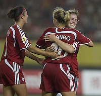 Canada defender (10) Martina Franko is congratulated on her goal by teammate Sophie Schmidt during their first round game at the 2007 FIFA Women's World Cup at Hangzhou Dragon Stadium in Hangzhou, China.  Canada defeated Ghana, 4-0.