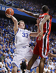 UK's Kyle Wiltjer attempts a shot around a Georgia defender at Rupp Arena on Friday, March 2, 2012. Photo by Scott Hannigan | Staff