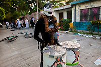 A young Salvadoran man, wearing a mask with face paint, carries drums before the start of the La Calabiuza parade at the Day of the Dead celebration in Tonacatepeque, El Salvador, 1 November 2016. The festival, known as La Calabiuza since the 90s of the last century, joins Salvador's pre-Hispanic heritage and the mythological figures (La Sihuanaba, El Cipitío, La Llorona etc.) collected from the whole Central American region, together with the catholic All Saints Day holiday and its tradition of honoring the dead relatives. Children and youths only, dressed up in scary costumes and carrying painted carts, march from the local cemetery to the downtown plaza where the party culminates with music, dance, drinking and eating pumpkin (Ayote) with honey.