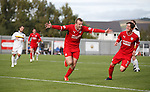 Greig Spence celebrates after scoring from the penalty spot for Raith Rovers