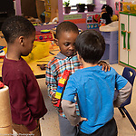 Education Preschool 3-4 year olds two boys talking about dispute while 3rd boy looks on