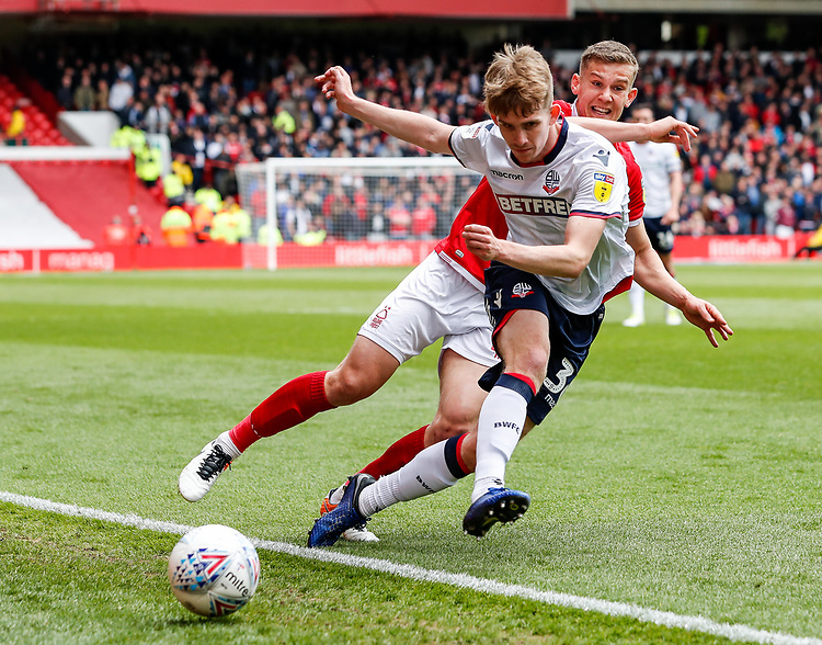 Bolton Wanderers' Harry Brockbankcompeting with Nottingham Forest's Ryan Yates <br /> <br /> Photographer Andrew Kearns/CameraSport<br /> <br /> The EFL Sky Bet Championship - Nottingham Forest v Bolton Wanderers - Sunday 5th May 2019 - The City Ground - Nottingham<br /> <br /> World Copyright © 2019 CameraSport. All rights reserved. 43 Linden Ave. Countesthorpe. Leicester. England. LE8 5PG - Tel: +44 (0) 116 277 4147 - admin@camerasport.com - www.camerasport.com